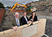 This image is free to use - Keith Brown  Minister for Housing and Transport  lays the foundation stone of the major new Affordable housing development under construction for Queens Cross Housing Association at Oban Drive  Glasgow. With Mr Brown at the £14.28m 128 home site (formerly the North Kelvinside School) for the ceremony were John Gray (Chairman Queens Cross Housing Association, left) and Shona Stephen (Ch Exec Queens Cross Housing Association) - for further information please contact Margaret Brannan (Communications Manager QXHA on 0141 589 7349 / 07791 461 154) - Picture by Donald MacLeod - 22.08.11 - 07702 319 738 - www.donald-macleod.com
