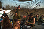 ISRAEL-GAZA BORDER, ISRAEL<br /> Israeli reserve soldiers are paid a visit by relatives in an army gathering site, on a day when a ceasefire was declared between Israel and Hamas, during operation Protective Edge. Several ceasefires were agreed upon and later broken, during the 8-week long war.