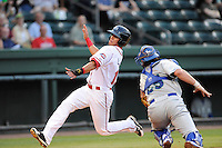 Center fielder Jesus Loya (17) of the Greenville Drive evades the tag to score against catcher Cam Gallagher of the Lexington Legends on Monday, August 16, 2013, at Fluor Field at the West End in Greenville, South Carolina. Lexington won, 5-1. (Tom Priddy/Four Seam Images)