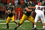 30 August 2008:     University of Missouri quarterback Chase Daniel (10, left) looks for a receiver but ran the ball instead at the 2008 State Farm Arch Rivalry game which was played at the Edward Jones Dome in St. Louis, Missouri, on August 30, 2008 with the Missouri Tigers coming into the game ranked 6th in the nation and The Fighting Illini ranked 20th.  Missouri defeated Illinois, 52-42.