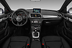 Stock photo of straight dashboard view of 2018 Audi Q3  2.0T-FWD-tiptronic-Premium-Plus  5 Door SUV