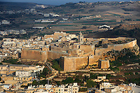 Aerial view of the Citadella and surrounding landscape, Victoria, Gozo, Malta, pictured on June 7, 2008, in the morning. The Republic of Malta consists of seven islands in the Mediterranean Sea of which Malta, Gozo and Comino have been inhabited since c.5,200 BC. Nine of Malta's important historical monuments are UNESCO World Heritage Sites, including the Citadella, which has been a fortified city since the Bronze Age. Sited on a hill above Victoria (or Rabat) which dominates the surrounding countryside and coast, it was built up by the Phoenicians and then the Romans into a complex Acropolis. In the Middle Ages the Citadel was used as a refuge for the population by the Order of the Knights of St John. In 1551 the island was attacked by Muslims and the population taken away into slavery. Most of the remaining architecture is military although some fine examples of Maltese Baroque were constructed over the military settlement, including the 17th century Cathedral. Picture by Manuel Cohen.