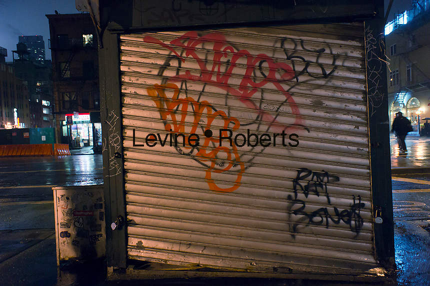 A graffiti covered closed newsstand in the Chelsea neighborhood of New York is seen on a wet evening on Thursday, January 26, 2012.  (© Richard B. Levine)