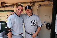 OAKLAND, CA - AUGUST 16:  From left: Jim Thome #25 and Mark Buehrle #57 of the Chicago White Sox get ready in the dugout before the game against the Oakland Athletics during the 1929-themed turn back the clock game at the Oakland-Alameda County Coliseum on August 16, 2009 in Oakland, California. Photo by Brad Mangin