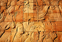 Carved mural in stone wall depicting Thailand life. Chiang Mai, Thailand.