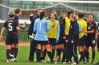 Meghan Schnur (center) is all smiles as the team celebrates post-game.  The USWNT defeated Iceland (2-0) at Vila Real Sto. Antonio in their opener of the 2010 Algarve Cup on February 24, 2010.
