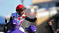 DEL MAR, CA - NOVEMBER 04: John Velazquez, aboard World Approval #5, is congratulated after winning the Breeders' Cup Mile race on Day 2 of the 2017 Breeders' Cup World Championships at Del Mar Racing Club on November 4, 2017 in Del Mar, California. (Photo by Jamey Price/Eclipse Sportswire/Breeders Cup)