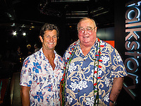 "HONOLULU, Turtle Bay Resort, North Shore, Oahu. - (Thursday, January 3, 2013)  Mark Warren (AUS) and Greg Noll (USA) who was the guest  speaker of Talk Story at Surfer The Bar tonight, Noll, nicknamed ""Da Bull"" by Phil Edwards in reference to his physique and way of ""charging"" down the face of a wave is an American pioneer of big wave surfing and is also acknowledged as a prominent longboard shaper. Noll was a member of a US lifeguard team that introduced Malibu boards to Australia around the time of the Melbourne Olympic Games. Noll became known for his exploits in large Hawaiian surf on the North Shore of Oahu. He first gained a reputation in November 1957 after surfing Waimea Bay in 25-30 ft surf when it had previously been thought impossible even to the local Hawaiians. He is perhaps best known for being the first surfer to ride a wave breaking on the outside reef at the so-called Banzai Pipeline in November 1964...It was later at Makaha, in December 1969, that he rode what many at the time believed to be the largest wave ever surfed. After that wave and the ensuing wipeout during the course of that spectacular ride down the face of a massive dark wall of water, his surfing tapered off and he closed his Hermosa Beach shop in the early 1970s. He and other surfers such as Pat Curren, Mike Stang, Buzzy Trent, George Downing, Mickey Munoz, Wally Froyseth, Fred Van Dyke and Peter Cole are viewed as the most daring surfers of their generation...Noll is readily identified in film footage while surfing by his now iconic black and white horizontally striped ""jailhouse"" boardshorts and was interviewed by host Jodi Wilmott (AUS). . Photo: joliphotos.com"