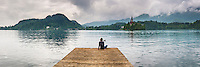 Lake Bled, Slovenia. Tourist on a jetty by Lake Bled Island, Bled, Julian Alps, Gorenjska, Slovenia, Europe