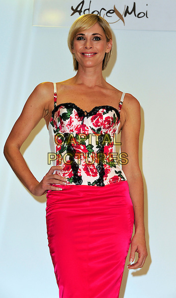JENNI FALCONER.The face and body of Adore Moi by Ultimo and Michelle Mone, the creator of the lingerie brand launch the Bin Your Bra campaign at Debenhams, London, England..October 6th, 2009.half length skirt hand on hip skirt white black pink lace floral print basque corset.CAP/CJ.©Chris Joseph/Capital Pictures.