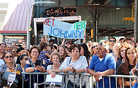 "12 June 2018, New York, USA: Fans wait for US Hollywood star John Travolta and his wife, actress Kelly Preston, in front of the food stall ""Lenny's Pizza"" on 86th Street in Bensonhurst. Travolta bought two slices of Margehrita in his role of Tony Manero in the classic disco movie ""Saturday Night Fever"" some 40 years ago. Photo: Christina Horsten/dpa /MediaPunch ***FOR USA ONLY***"