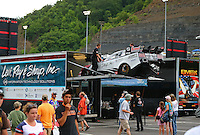 Jun 20, 2015; Bristol, TN, USA; Crew members load the car of NHRA funny car driver Tim Wilkerson into the hauler prior to the start of the final qualifying session for the Thunder Valley Nationals at Bristol Dragway. Mandatory Credit: Mark J. Rebilas-USA TODAY Sports
