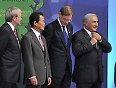 Washington, D.C. - November 15, 2008 -- Dominique Strauss-Kahn, right, adjusts his tie as Kevin Rudd, Prime Minister of Australia, left, Prime Minister Taro Aso of Japan, center left, and Robert B. Zoellick, President, World Bank Group, center right, look on as they prepare for a Photo Opportunity with Summit on Financial Markets and the World Economy leaders to the National Building Museum in Washington, D.C. on Saturday, November 15, 2008..Credit: Ron Sachs / Pool via CNP
