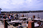 AMHJEA People at cafe tables Southwold pier Suffolk England