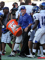 Armwood Hawks head coach Sean Callahan after getting the water dumped over his head during the fourth quarter of the Florida High School Athletic Association 6A Championship Game at Florida's Citrus Bowl on December 17, 2011 in Orlando, Florida.  Armwood defeated Miami Central 40-31.  (Mike Janes/Four Seam Images)