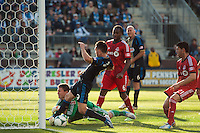 Toronto FC goalkeeper Joe Bendik (12) and Jack McInerney (9) of the Philadelphia Union go for the ball. Toronto FC and the Philadelphia Union played to a 1-1 tie during a Major League Soccer (MLS) match at PPL Park in Chester, PA, on April13, 2013.