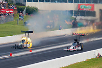 Jun 9, 2019; Topeka, KS, USA; NHRA top fuel driver Billy Torrence (right) races alongside Lex Joon during the Heartland Nationals at Heartland Motorsports Park. Mandatory Credit: Mark J. Rebilas-USA TODAY Sports
