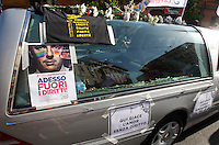 "Un momento del Gay Pride a Roma, 7 giugno 2014.<br /> A hearse carrying the of a skeleton, with signs at bottom, reading ""Here lies love without right"" makes his way during the Gay Pride in Rome, 7 June 2014. The sign at left, with a picture of Italian Premier Matteo Renzi, reads ""Now get rights out!""<br /> UPDATE IMAGES PRESS/Riccardo De Luca"