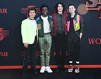 "28 June 2019 - Santa Monica, California - Gaten Matarazzo, Caleb McLaughlin, Finn Wolfhard, Noah Schnapp. ""Stranger Things 3"" Los Angeles Premiere held at Santa Monica High School. Photo Credit: Birdie Thompson/AdMedia"