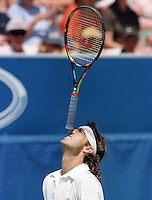 Fernando Mekigeni of Brazil balances the racquet on the tip of his nose during his match against Todd Martin of the UNited States in the first round at the Australian Open Tennis Championships, Melbourne, Australia, Tuesday, January 19, 1999. Martin won the match 3-6, 4-6, 6-3, 6-4, 6-1. (AP Photo/)