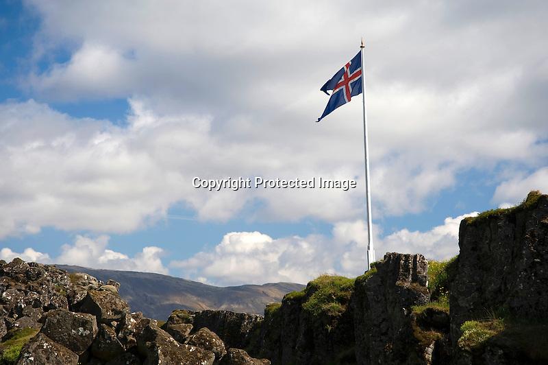 Icelandic Flag Flying on Historic Logberg Rock in Thingvellir National Park in South Iceland
