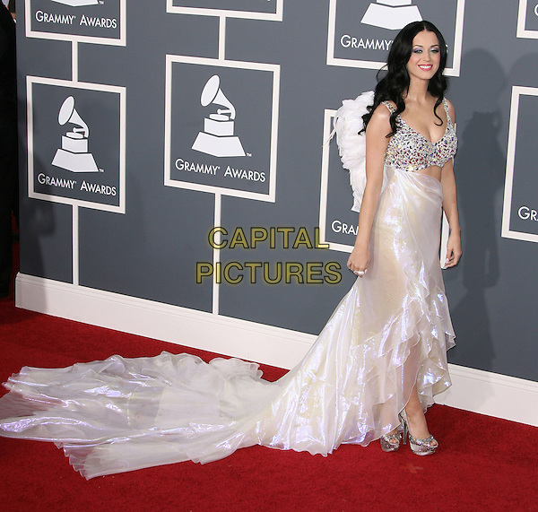 KATY PERRY.The 53rd Annual GRAMMY Awards held at the Staples Center, Los Angeles, California, USA..February 13th, 2011.arrivals grammys full length white long maxi angel wings dress train shimmery shiny silver beaded cut out embellished platform peep toe shoes .CAP/ADM.©AdMedia/Capital Pictures.