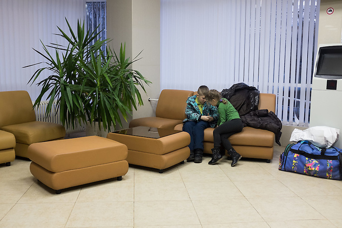 kids of Anatolij - Angelina and Grigori, are waiting for their newborn brother Daniil in the hall of Moscow hospital 20