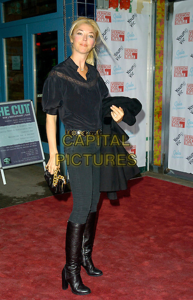 TAMARA BECKWITH.Vernon God Little - gala performance, The Young Vic theatre, London, England..May 10th, 2007 .full length black jeans denim skinny tucked into brown boots top gold studs studded belt chain bag purse carrying coat jacket .CAP/CAN.©Can Nguyen/Capital Pictures