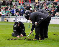Ground staff repair the pitch during the RBS 6 Nations match between Ireland and England at the Aviva Stadium, Dublin on Sunday 10 February 2013 (Photo by Rob Munro)