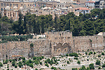 The Eastern Gate, the Golden Gate or the Gate of Mercy of the Old City of Jerusalem with the Temple Mount or al-Haram ash-Sharif behind it.  In front is a Muslim cemetery with the Muslim Quarter in the background. The Old City of Jerusalem and its Walls is a UNESCO World Heritage Site.  This gate has been walled up since the 1500's.