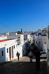 Alleyway down hill village whitewashed houses Vejer de la Frontera, Cadiz Province, Spain