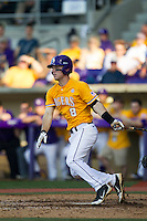 LSU Tigers shortstop Alex Bregman (8) follows through on his swing during the Southeastern Conference baseball game against the Texas A&M Aggies on April 25, 2015 at Alex Box Stadium in Baton Rouge, Louisiana. Texas A&M defeated LSU 6-2. (Andrew Woolley/Four Seam Images)