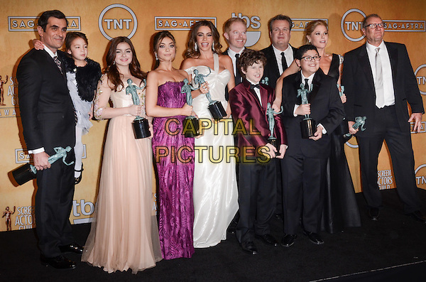 Ty Burrell, Aubrey Anderson-Emmons, Ariel Winter, Sarah Hyland, Sofia Vergara, Nolan Gould, Jesse Tyler Ferguson, Eric Stonestreet, Rico Rodriguez, Julie Bowen, Ed O'Neill of Modern Family.Pressroom at the 19th Annual Screen Actors Guild Awards held at The Shrine Auditorium, Los Angeles, California, USA..27th January 2013.SAG SAGs full length black dress suit fur cape pink purple lace strapless award trophy trophies winner winners .CAP/ADM/TW.©Tonya Wise/AdMedia/Capital Pictures.