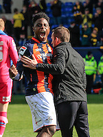 Pelly Ruddock of Luton Town celebrates the win with manager Nathan Jones after the Sky Bet League 2 match between Oxford United and Luton Town at the Kassam Stadium, Oxford, England on 16 April 2016. Photo by Liam Smith.