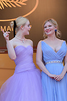 www.acepixs.com<br /> <br /> May 24 2017, Cannes<br /> <br /> (L-R) Elle Fanning and Kirsten Dunst arriving at the premiere of 'The Beguiled' during the 70th annual Cannes Film Festival at Palais des Festivals on May 24, 2017 in Cannes, France.<br /> <br /> By Line: Famous/ACE Pictures<br /> <br /> <br /> ACE Pictures Inc<br /> Tel: 6467670430<br /> Email: info@acepixs.com<br /> www.acepixs.com