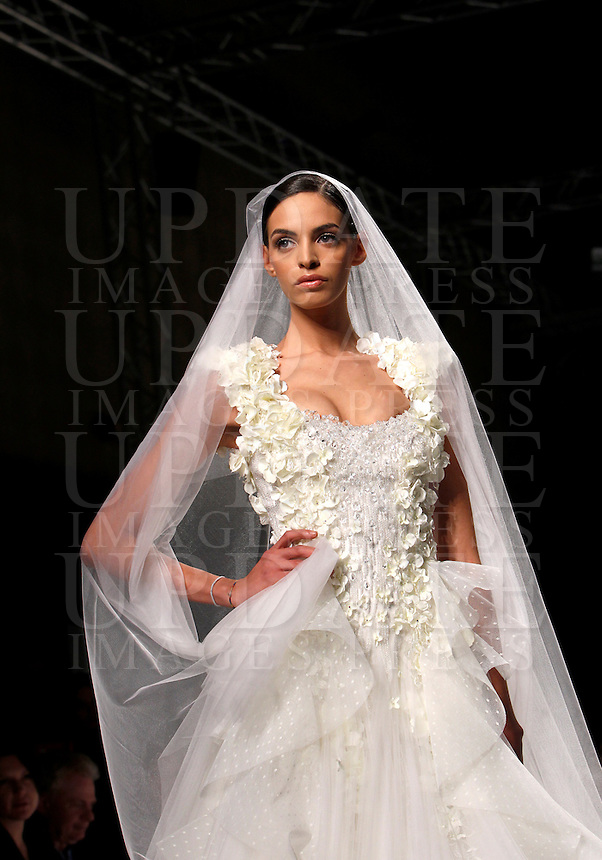 Una modella presenta un abito da sposa della collezione Primavera-Estate 2013 dello stilista libanese Abed Mahfouz durante la rassegna Altaroma a Roma, 28 gennaio 2013..A model wears a wedding dress of the Spring Summer 2013 collection by the Lebanese stylist Abed Mahfouz, during the Altaroma fashion week in Rome, 28 January 2013..UPDATE IMAGES PRESS/Isabella Bonotto