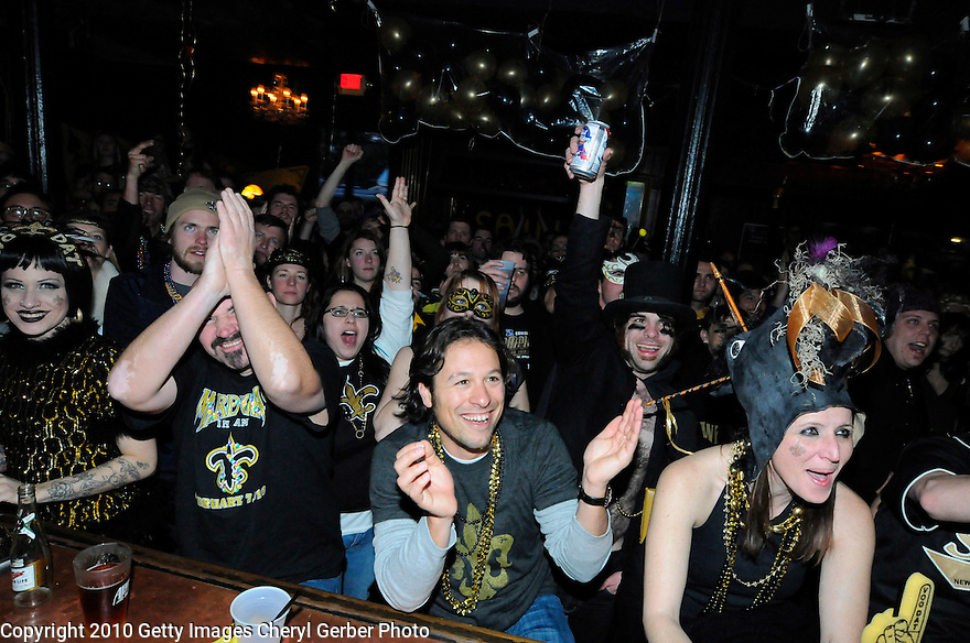 NEW ORLEANS - FEBRUARY 07:  New Orleans Saints fans Angie Jakusz, Reuben Brody, Colin O'Neill and Wendy Chisholm watch the Saints play against the Indianapolis Colts during Super Bowl XLIV at a bar on February 7, 2010 in New Orleans, Louisiana.  (Photo by Cheryl Gerber/Getty Images)