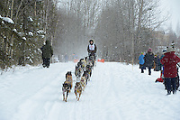 Marie-Anick Elie passes by University Lake during the first day of the World Championship Sled Dog Races, a highlight of the 2013 Anchorage, Alaska, Fur Rendezvous.