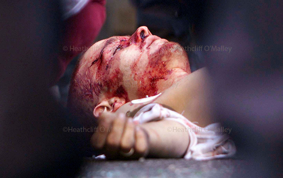 PIC BY HEATHCLIFF O'MALLEY.a protestor killed by the police during g8 riots in genova.