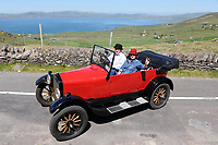 SUNDAY 23-5-2010: William and Valerie Cuddy from Glountane, Cork in their 1926 Model T Ford which was built in Cork City pictured climbing Coomakista Pass in the 31st annual Kingdom Vintage, Veteran and Classic Ring Of Kerry car run  outside Waterville in County Kerry on Sunday morning.<br />Picture by Don MacMonagle