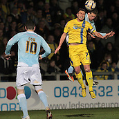 15.01.2013. Torquay, England. Torquay's Lee Mansell and Exeter's Scott Bennett in action during the League Two game between Torquay United and Exeter City from Plainmoor.