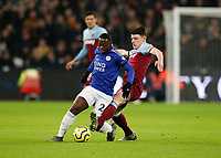 28th December 2019; London Stadium, London, England; English Premier League Football, West Ham United versus Leicester City; Declan Rice of West Ham United challenges Nampalys Mendy of Leicester City - Strictly Editorial Use Only. No use with unauthorized audio, video, data, fixture lists, club/league logos or 'live' services. Online in-match use limited to 120 images, no video emulation. No use in betting, games or single club/league/player publications