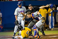 June 07, 2009:  NCAA Super Regional: Southern Miss Golden Eagles vs Florida Gators:    Florida catcher Buddy Munroe (4) stands over Southern Miss DH Corey Stevens (15) after tagging Stevens out at homeplate during game two of Super Regional action at Alfred A. McKethan Stadium on the campus of University of Florida in Gainesville.  Southern Miss came from behind to defeat Florida 7-6 and to advance to the College World Series.   ...........