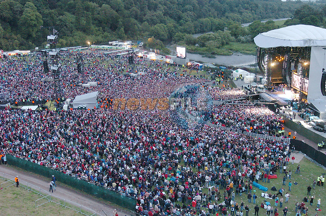 Some of the 80,000 crowd gathered for Madonna's first Irish Concert at Slane Castle..Photo /NEWSFILE/Eoin Clarke.(Photo credit should read Eoin Clarke/NEWSFILE)...This Picture has been sent you under the condtions enclosed by:.Newsfile Ltd..the Studio,.Millmount Abbey,.Drogheda,.Co Meath..Ireland..Tel: +353(0)41-9871240.Fax: +353(0)41-9871260.GSM: +353(0)86-2500958.email: pictures@newsfile.ie.www.newsfile.ie.FTP: 193.120.102.198..This picture is from Fran Caffrey@newsfile.ie