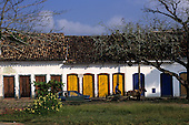 Paraty, Brazil. Single storey colonial commercial buildings with multiple doorways. Rio de Janeiro State.