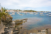 Spain, Costa Brava, Catalonia, Cadques. Boats docked in the harbor.