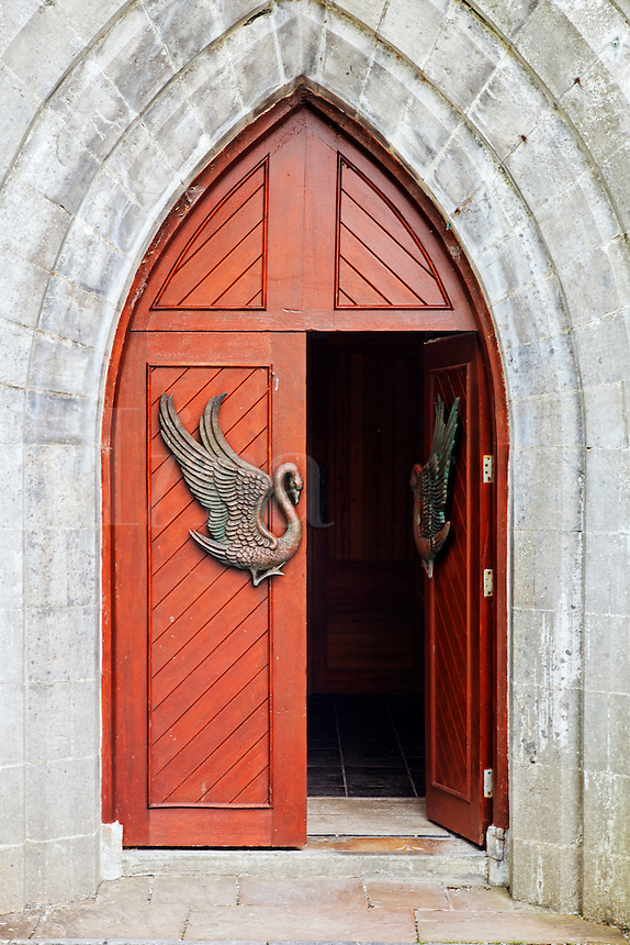 Swan figure on red arched doorway to St. Columba's Church, Drumcliffe, County Sligo, Republic of Ireland