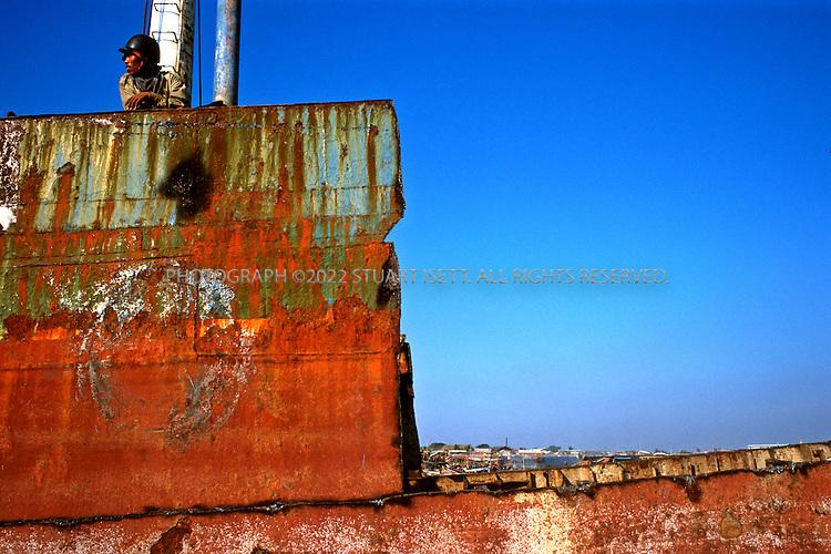 Shipbreakers. Jakarta, Indonesia. June, 1999..Photograph by Stuart Isett.©2004 Stuart Isett. All rights reserved