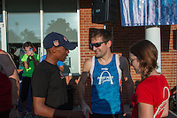 Meb Keflezghi talks with Fleet Feet employees Jules Vogel and Andy Koziatek just before the start of the Run with Meb run at the Fleet Feet Des Peres store in St. Louis County, MO. Wednesday, September 3, 2014.