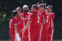 Monty Panesa of Hornchurch celebrates with his team mates after taking the wicket of Hassan Chowdhury during Wanstead and Snaresbrook CC vs Hornchurch CC, Shepherd Neame Essex League Cricket at Overton Drive on 30th June 2018